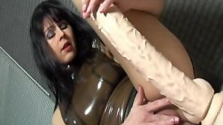 German Doll Playing With A Dick In A Latex Dress