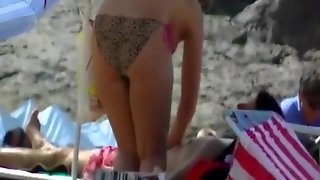 Busty Woman Topless In Beach