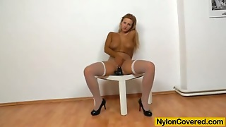 Sassy Blond In Nylons Is Enjoying That Dildo Though Nylons