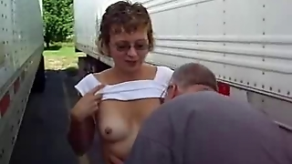 Mature Woman Sucks Cock Between Trucks In Parking Lot