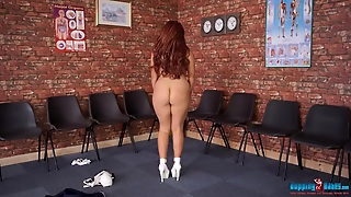 Voluptuous Redheaded Nurse In A Naughty Striptease