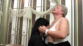 Granny Seduces A Young Lady With Sexy Kisses