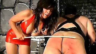 Dominatrix Caning Lazy Guy Ass