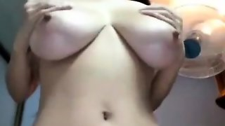 Hottie With Large Boobs On Webcam