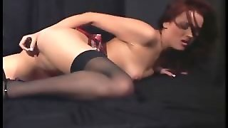 Redhead With A Dildo In Sheer Stockings And Heels