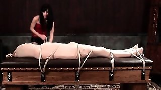 Wrapped Up Guy Gets Whipped And Roped Tightly