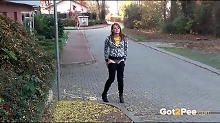 Cute Girl Walking Down The Street Takes A Piss