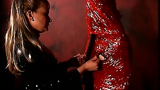 Latex Mistress Zips Up Her Slave In A Latex Bag With Nipple Exposed