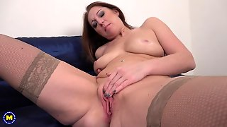 Sexy Amateur Mom Masturbates In Fishnet Stockings