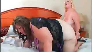 Lesbian Bbw Duo Fucking A Strap-On In Bed