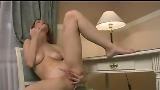 Redhead Fingers Her Pussy