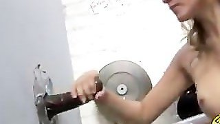 Gloryhole Slut Sucks A Huge Black Cock