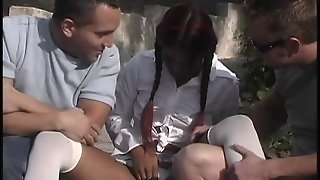 An Asian Girl With Pigtails Gets Double Penetrated Outdoors