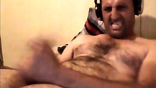 Evil Face Jerking Off His Cock And Cums On His Stomach