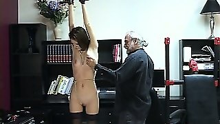 Petite Beauty In A Corset  Feels The Pain Of True Device Bondage