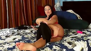 Horny Brunet Bitch Is Sitting On Her Bed And Playing With Her Feet And Big Boobs