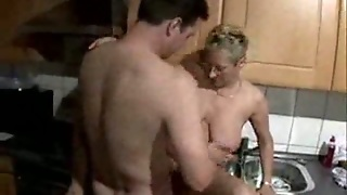 Mature Gets Fucked In The Kitchen