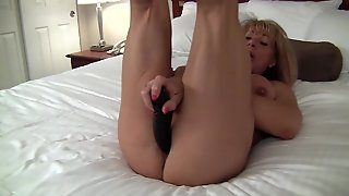 Muscular Woman With Black Dildo