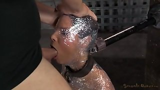 Slave Wrapped In Plastic And Mouth Fucked