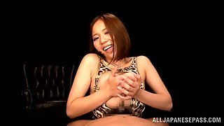 Marvelous Asian Bombshell Delivers An Endearing Hand Job And Titjob