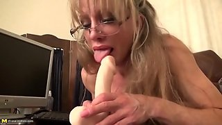 Huge Clit And Fake Tits On This Classy Mature Chick