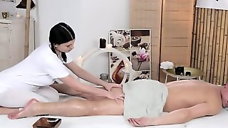 Busty Masseuse Lucy Li Gives Man Footjob After Fucking
