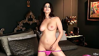 Turned On Gorgeous Long Haired Glamorous Brunette Sunny Leone With Big Juicy Hooters Takes Off Her Arousing Lingerie While Rubbing Her Shaved Honey Pot In Kinky Black Bedroom