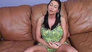 Woman Sitting Cross-Legged On The Couch
