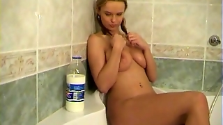 Busty Peach Plays With Milk & Melons