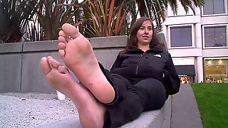 Sexy Girl Showing Her Bare Feet Outdoors