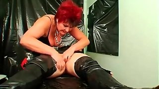 Girl In Latex Bag Unwrapped And Dominated By Mistress