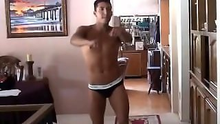Latin Man Does Strip Tease Dance For His Girlfriend.