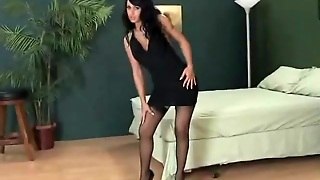 Sexy Black Dress And Stockings On A Babe