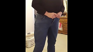 Putting On Her Girdle Over Big Tits, Jeans