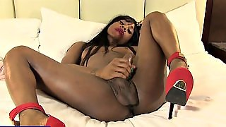 Black Shemale Cupid Drinks Her Big Cock