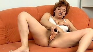 Old Girl With A Dildo