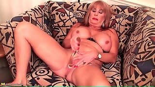 Sultry Old Lady In Lipstick Fucks A Dildo