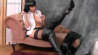 Hot Busty Babe Puts On Her Thigh High Leather Boots