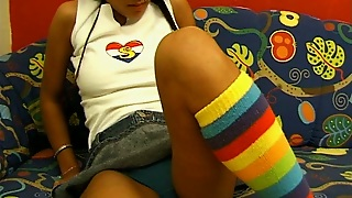 Pretty Teen In Funny Stockings And Short Jeans Skirt Plays In Solo