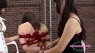 Asian Girl With Breast Bondage Getting Her Pussy Rubbed With Sticks Spanked By 2 Mistresses