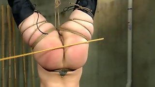 Bound Slave Suspended And Caned