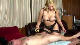 Dominant Masseuse Punishes Client With Heels