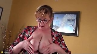 Granny In Black Stockings Fucks A Toy