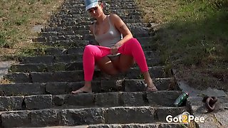 Chick Drops Her Hot Pink Spandex To Piss In Public