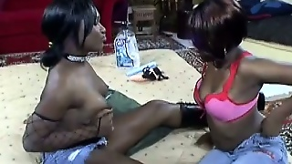 Two Wonderful Black Lesbians Have Lots Of Fun With A Strap-On Dildo