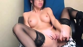 Stunning Lady In Lingerie Plays With Dildo