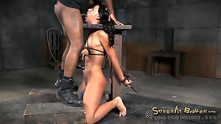Girl In A Bondage Device Mouth Fucked By Two Guys