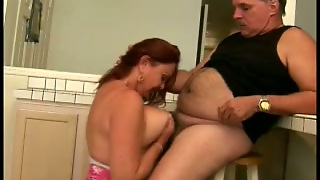 Gorgeous Redhead Cougar Blows A Mature Fat Man In The Kitchen