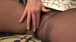 Pantyhose Seductress Takes Us Close To Her Cunt