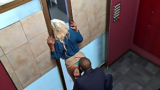 Bridgette B Secretly Takes The Cock While Talking To Her Boss Outside The Elevator
